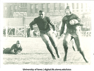 Duke Slater of the Iowa Hawkeyes chasing a ball carrier in a game around 1920