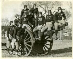 1936 Morgan Park Military Academy football team photo on the school cannon