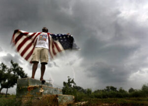Photo of a man with the American flag after Hurricane Katrina
