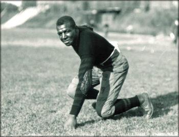 Duke Slater in an offensive lineman stance