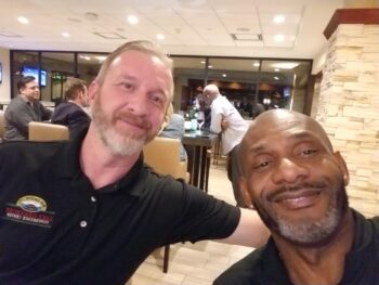 Kyle Smith of the USFL project with Derek Holloway Sr.